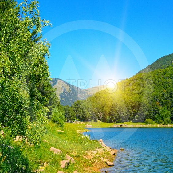 picturesque lake, mountains and blue sky