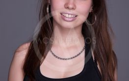 Happy and beautiful young woman,  studio shot