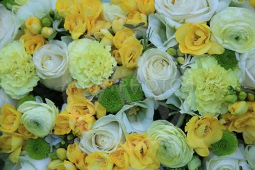 yellow and white floral arrangement