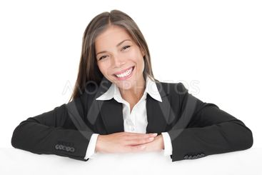 Businesswoman leaning on blank white sign