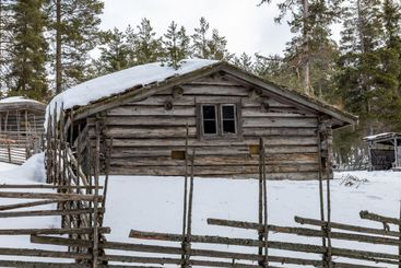 Traditional log house in winter.