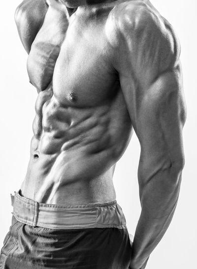 Male muscular upper body flexing