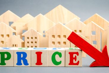 Wooden blocks with the word Price, down arrow and wooden...