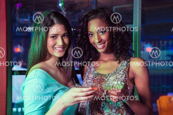 Portrait of two women having cocktail