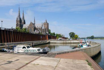 Dutch village Cuijk along river Meuse Martinus-church