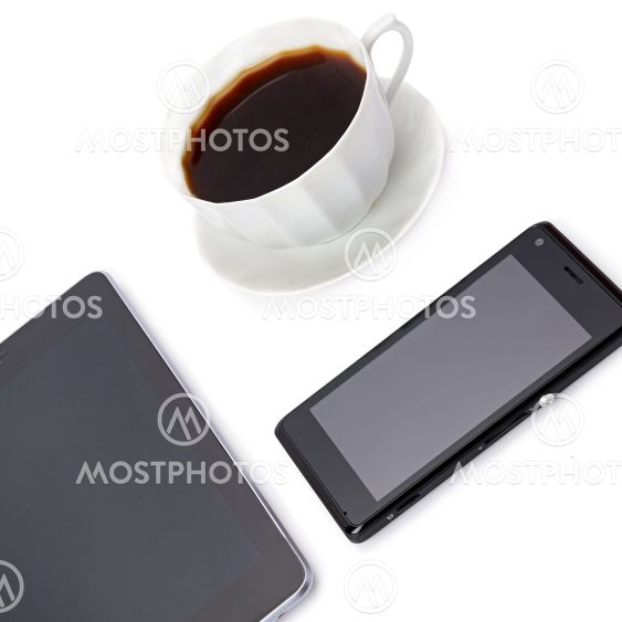 Smartphone, tablet and coffee cup isolated on white ....