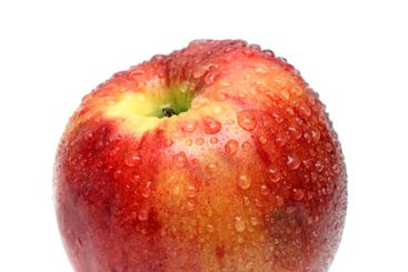 wet red apple with water drops
