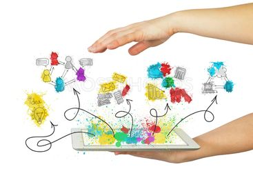 Hands hold tablet pc with business sketches