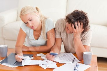 Unhappy couple listing expenses