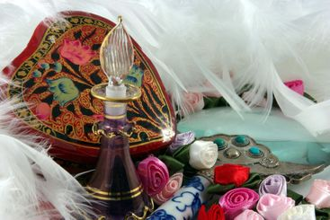 Perfume Bottle, Flowers And Feathers