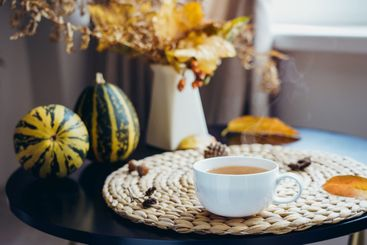 Hot steaming cup of coffee, tea with autumn bouquet,...