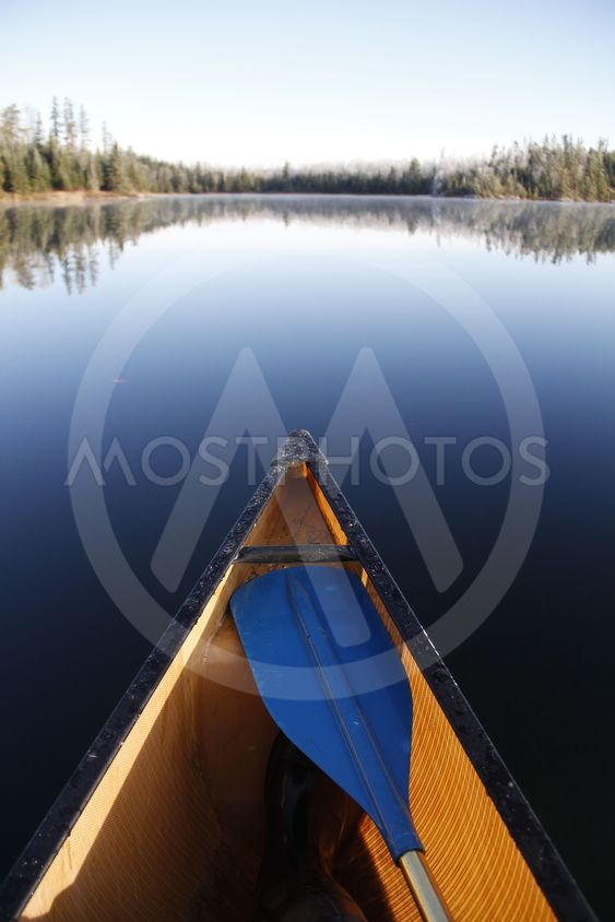 Canoe on smooth lake