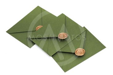 green envelope with designer cardboard and seal on a...