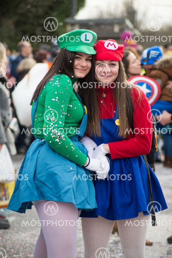 girls with super Mario costume posing in the street...