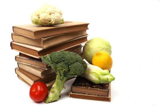 Old cookbooks with several vegetables