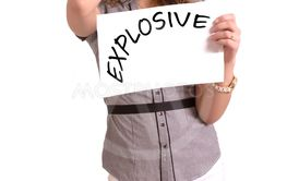 uncomfortable woman holding paper with Explosive text