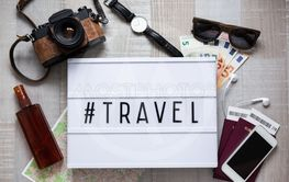 travel concept - top view of travel objects on wooden...