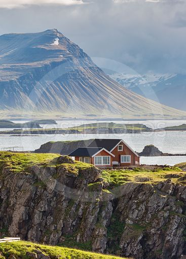 Red cottage in coastal area in Iceland.