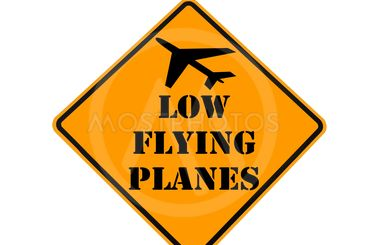road sign warning of low flying planes