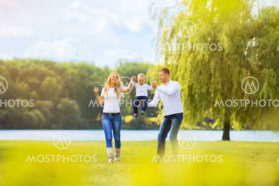 happy mother,father and son on a walk on Sunny day