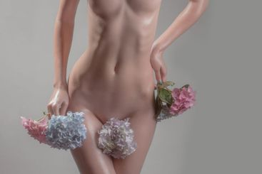 sexy naked woman with hydrangea flowers