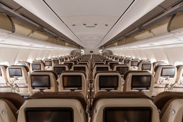 Swiss Airbus A340-300 airplane Economy Class cabin...