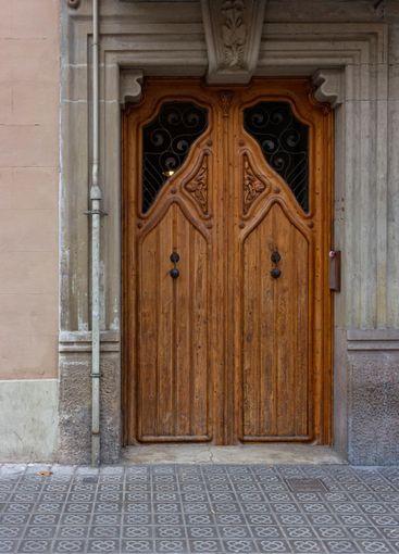 Nice wooden door in one of the streets of Barcelona