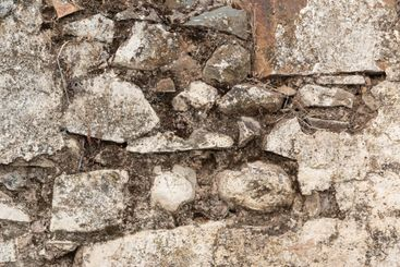 Stone wall of an old house in a village
