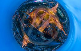 Mini planet Night Aerial view panorama of a freeway...