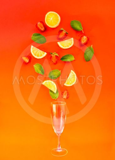 Flat lay Strawberry lemonade ingredients - lemon slices,...