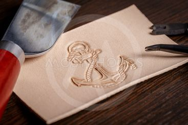work on leather goods using leather tools