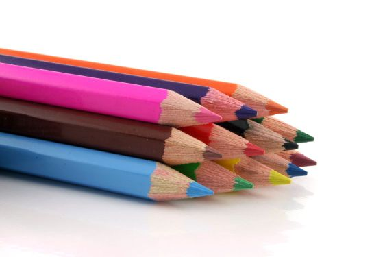 Stack of colored pencils on a white background