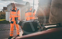 Garbage removal men working for a public utility