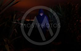 Hooded, Bearded Man in the Dark