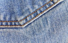 Fragment of classic blue fashioned jeans