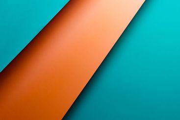 Orange and blue metallic flat lay background with sharp...