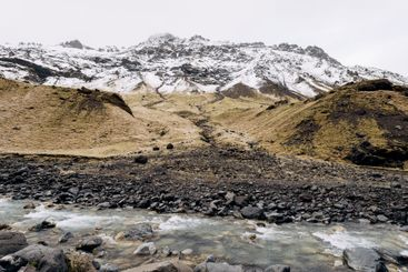 Mountain river at the foot of the mountain with a...