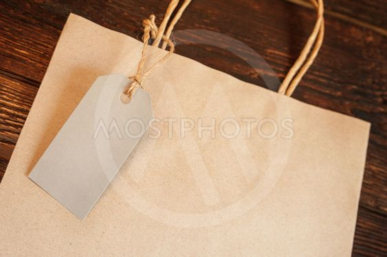 Mockup craft paper shopping bag with tag on vintage...