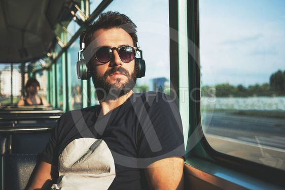 Young man riding in public transport
