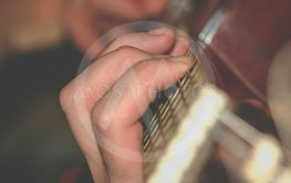 Fingers on guitar neck