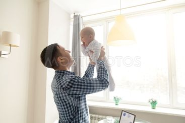 Young man throwing a baby