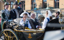 The carriage with the Queen Silvia and King Carl Gustav...