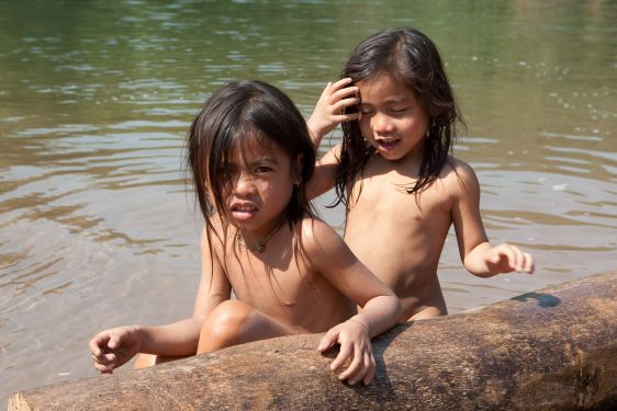 Children of Asia at river Nam Ou in Laos
