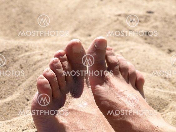 Female foots on beach