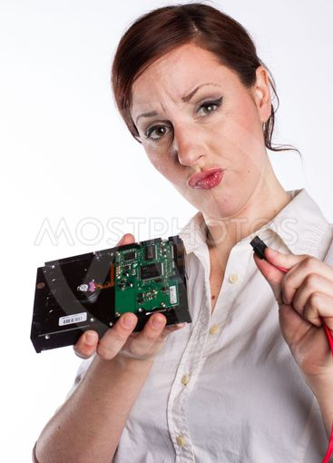 Confused Woman with Hard Drive