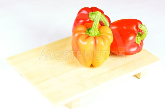 fresh and juicy vegetables on the wood plate isolated
