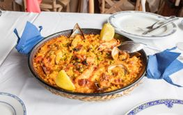typical Spanish paella with seafood ready to serve in...
