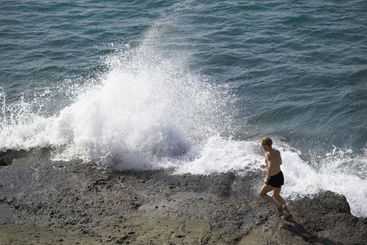 Ocean Surf and a Jogger