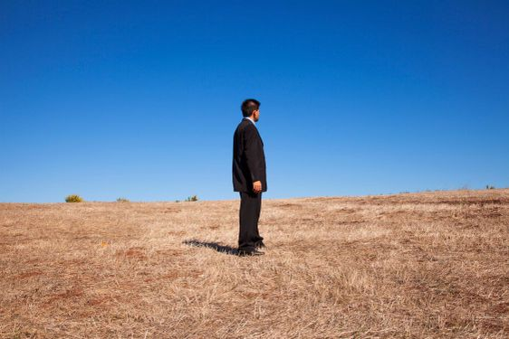 Businessman looking at the field
