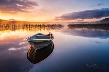 Boat at Lake Finnsjön at sunrise. Härryda kommun, Sweden.